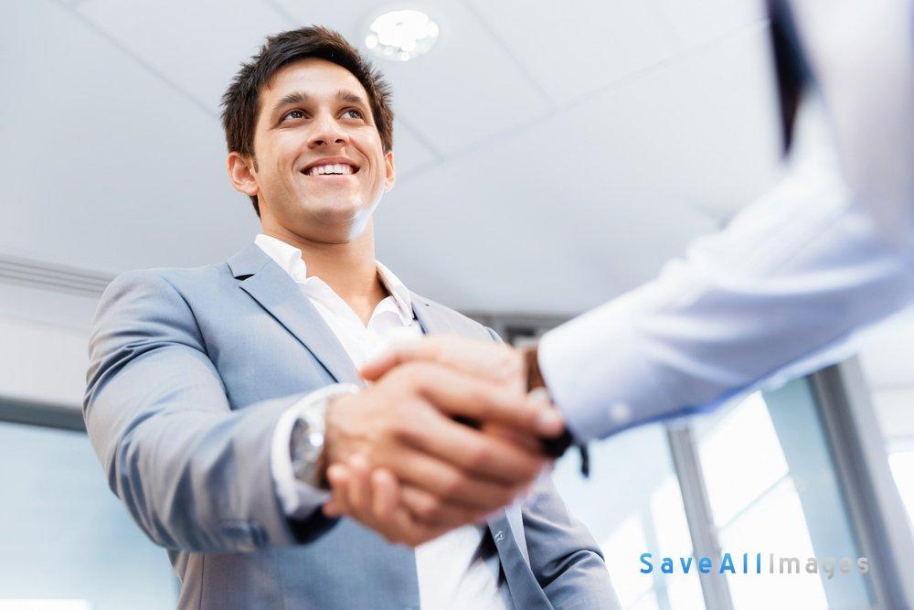 Handshake of businessmen greeting each other.jpeg
